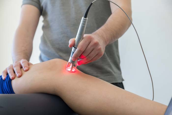 bigstock-Laser-Therapy-On-A-Knee