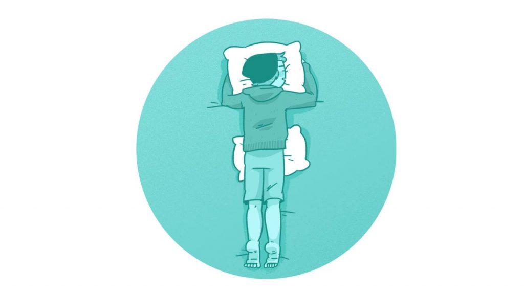 روی شکم بخوابید و یک بالش را زیر شکم خود قرار دهید